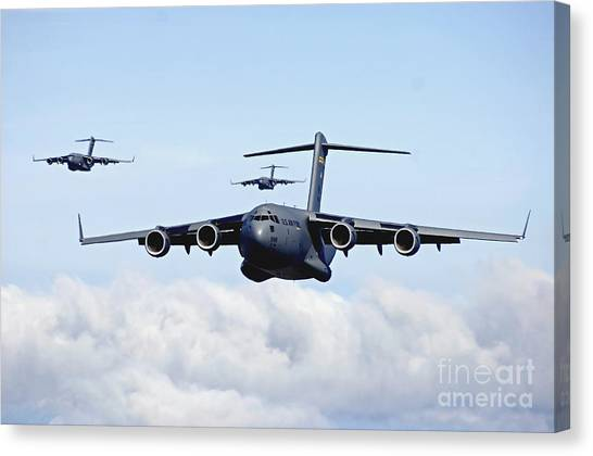 Canvas Print featuring the photograph U.s. Air Force C-17 Globemasters by Stocktrek Images