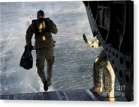 Green Berets Canvas Print - U.s. Army Green Beret Exits A Ch-47 by Stocktrek Images