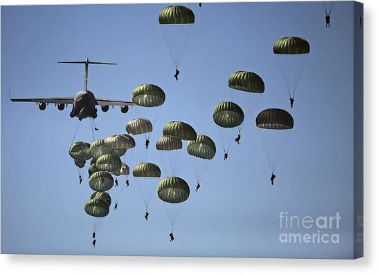 Canvas Print featuring the photograph U.s. Army Paratroopers Jumping by Stocktrek Images