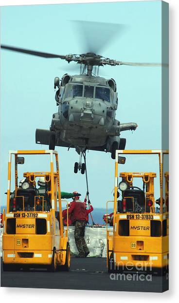 Forklifts Canvas Print - U.s. Navy Sailors Attach A Sling by Stocktrek Images