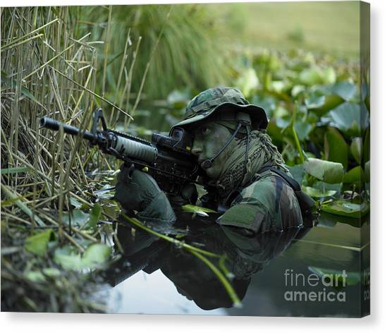 Special Forces Canvas Print - U.s. Navy Seal Crosses Through A Stream by Tom Weber