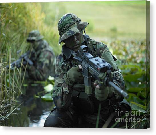 Special Forces Canvas Print - U.s. Navy Seals Cross Through A Stream by Tom Weber