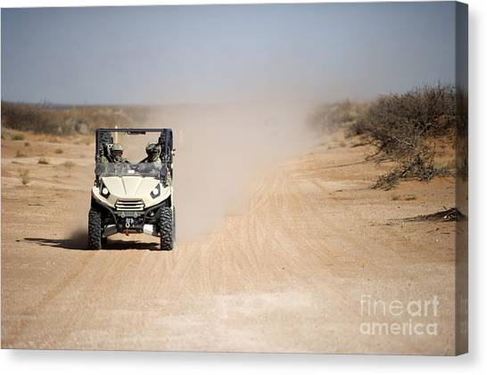Green Berets Canvas Print - U.s. Soldiers Drive A Ltatv Down A Dirt by Stocktrek Images