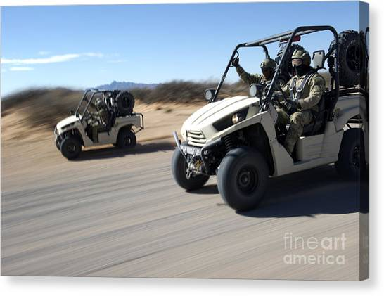 Green Berets Canvas Print - U.s. Soldiers Drive Multiple Ltatvs by Stocktrek Images