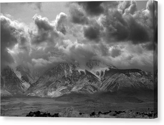 Valley Storm Canvas Print by John Derousseau