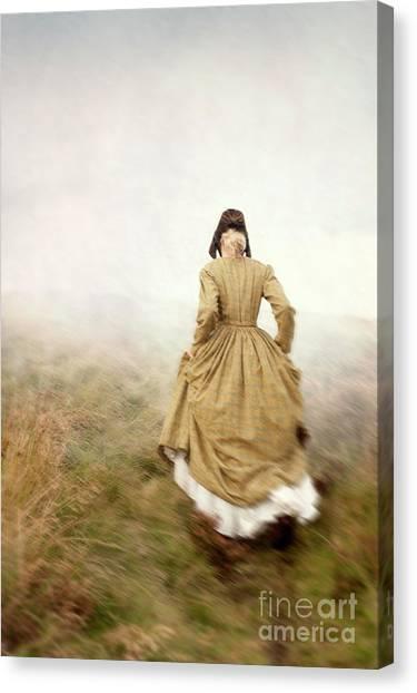 Victorian Woman Running On The Misty Moors Canvas Print