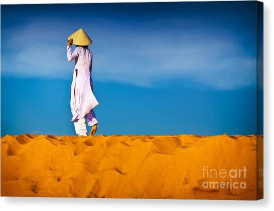 Vietnamese Woman In The Red Sand Dunes Mui Ne Vietnam Canvas Print