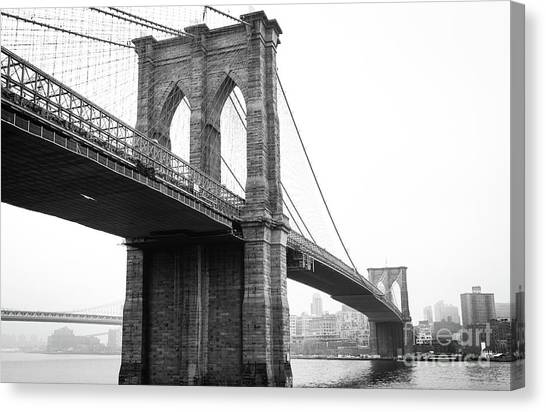 View Brooklyn Bridge With Foggy City In The Background Canvas Print