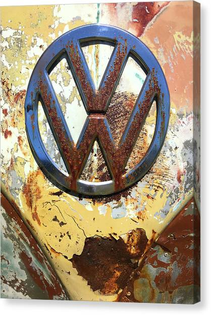 Canvas Print featuring the photograph Vw Volkswagen Emblem With Rust by Kelly Hazel