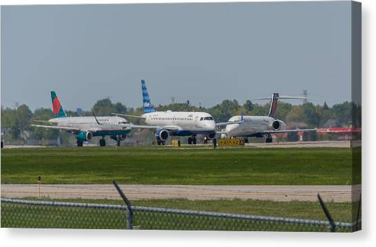 Jetblue Canvas Print - Vying For Position by Guy Whiteley
