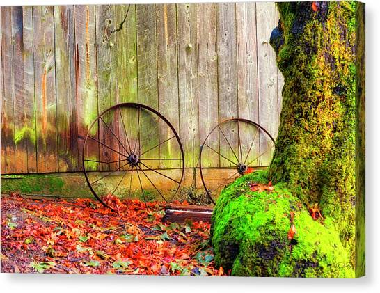 Wagon Wheels And Autumn Leaves Canvas Print