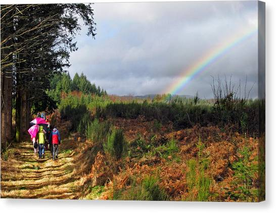 Walkers With Rainbow Canvas Print