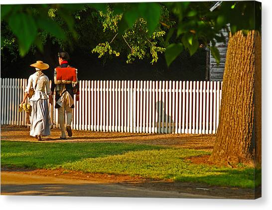 Walking Couple - Williamsburg Canvas Print by Panos Trivoulides
