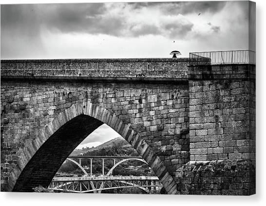 Walking On The Roman Bridge Canvas Print