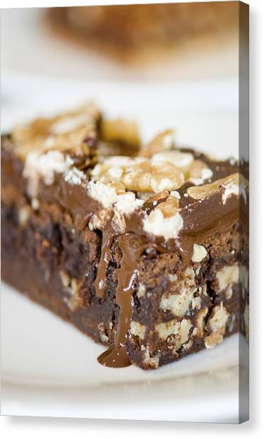 Walnut Brownie On A White Plate Canvas Print