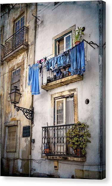 Urban Decay Canvas Print - Washday Blues In Lisbon Portugal  by Carol Japp