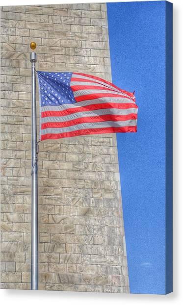 Washington Monument Canvas Print - Washington Monument With The American Flag by Marianna Mills