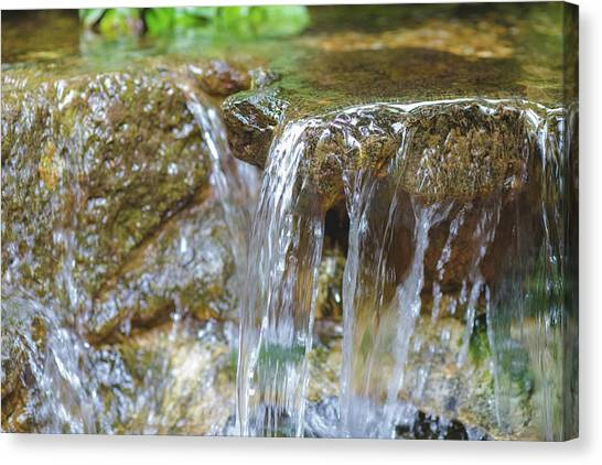 Canvas Print featuring the photograph Water On The Rocks by Raphael Lopez