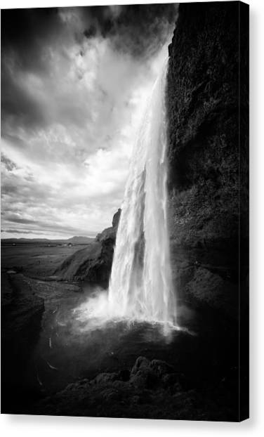 Canvas Print featuring the photograph Waterfall In Iceland Black And White by Matthias Hauser