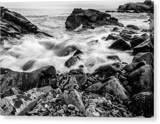 Canvas Print featuring the photograph Waves Against A Rocky Shore In Bw by Doug Camara