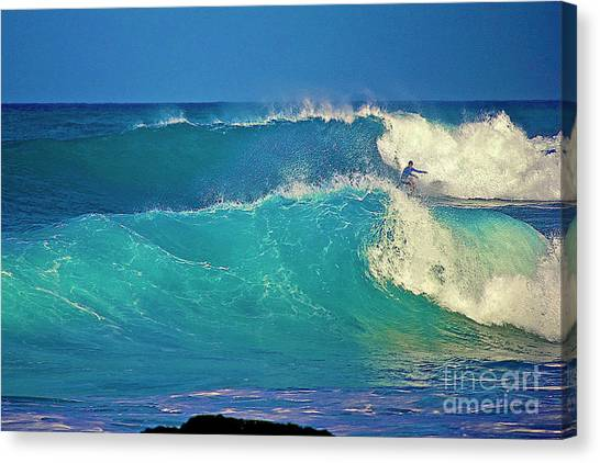 Waves And Surfer In Morning Light Canvas Print