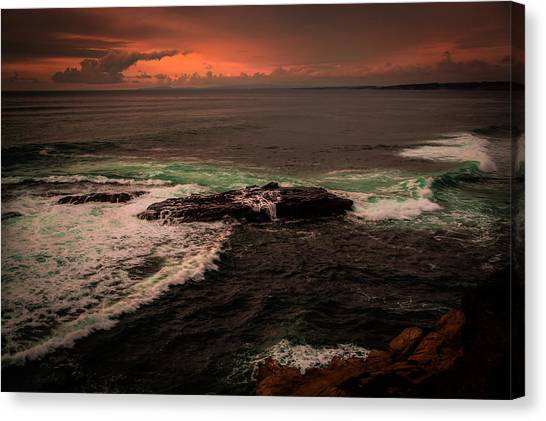 Waves Breaking Over The Rocks Canvas Print