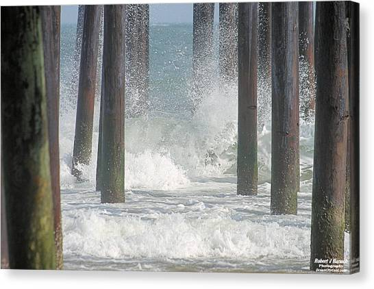Waves Under The Pier Canvas Print