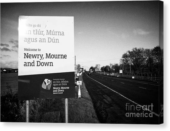 Brexit Canvas Print - welcome to newry mourne and down district council sign on the irish border between Northern Ireland  by Joe Fox