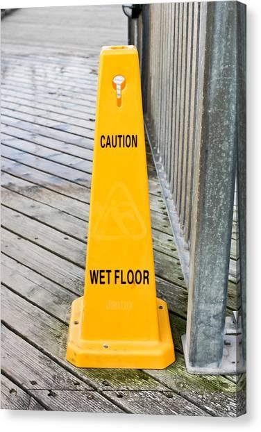 Caution Canvas Print - Wet Floor Warning by Tom Gowanlock