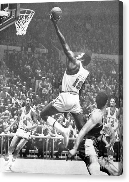 New York Knicks Canvas Print - Willis Reed Soars Over Wilt Chamberlain For A Basket. 1970 by William Jacobellis