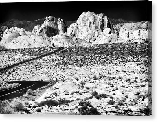 Winding In The Desert Canvas Print by John Rizzuto