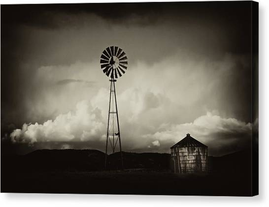 Windmill And Tank Canvas Print by Gus McCrea