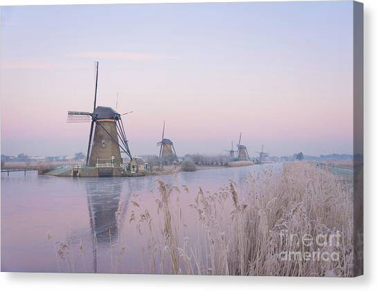 Windmills In The Netherlands In The Soft Sunrise Light In Winter Canvas Print