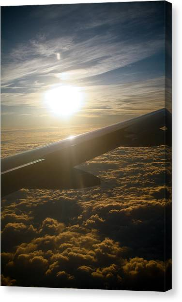 Winged Sun Canvas Print by Larry Underwood