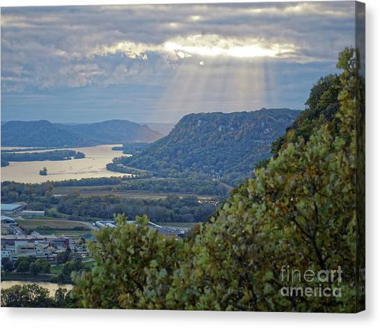 Canvas Print featuring the photograph Winona Garvin Heights With Sunbeams by Kari Yearous