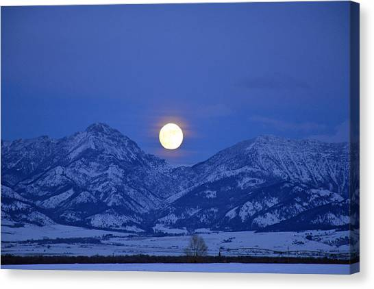 Winter Full Moon Over The Rockies Canvas Print