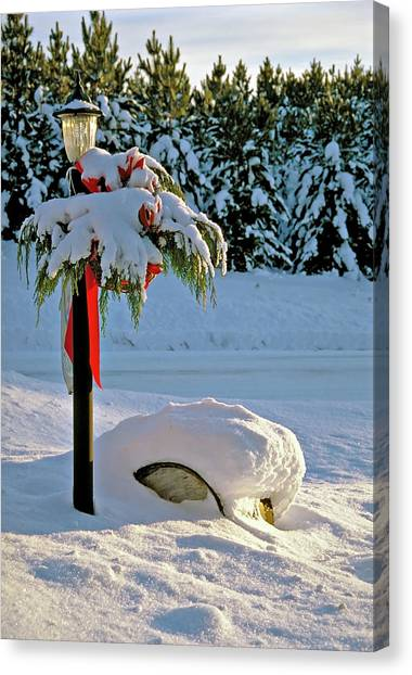 Winter Lamp Post In The Snow With Christmas Bough Canvas Print