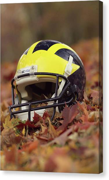 Canvas Print featuring the photograph Wolverine Helmet In October Leaves by Michigan Helmet