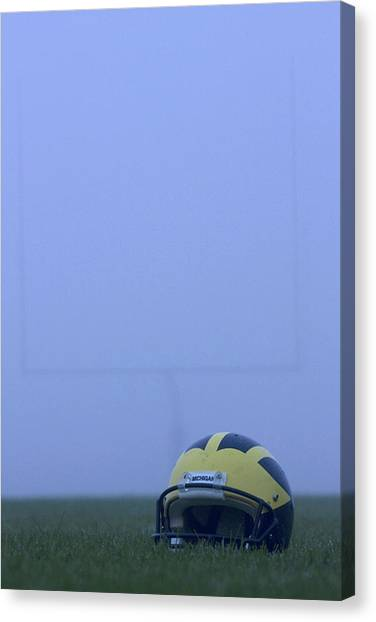 Wolverine Helmet On The Field In Heavy Fog Canvas Print
