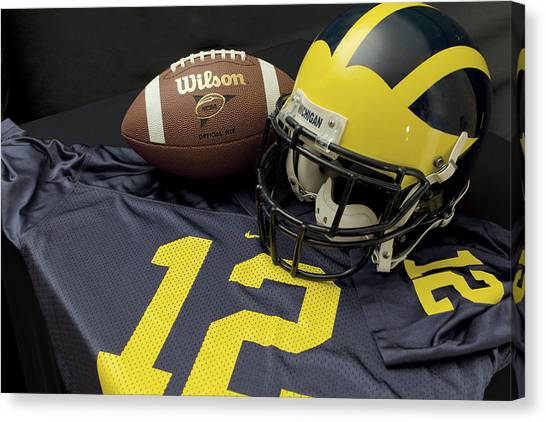 Wolverine Helmet With Football And Jersey Canvas Print