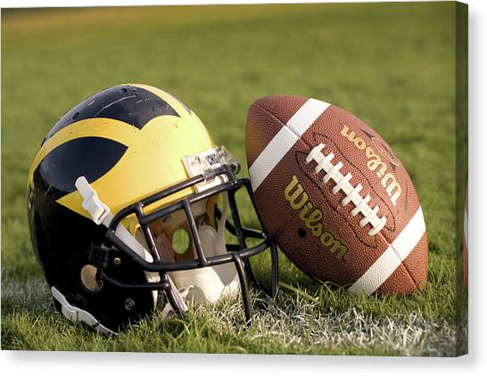 Wolverine Helmet With Football On The Field Canvas Print