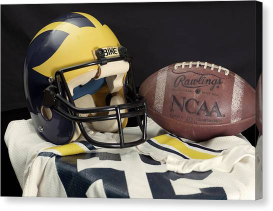 Wolverine Helmet With Jersey And Football Canvas Print