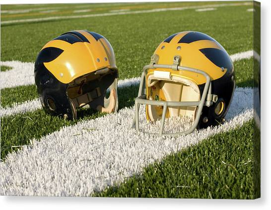Wolverine Helmets From Different Eras On The Field Canvas Print