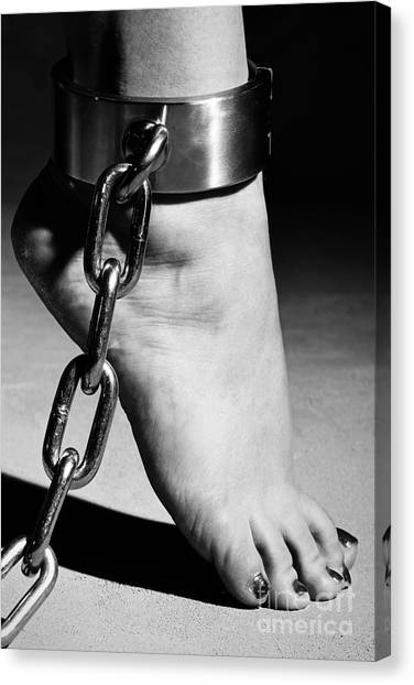Woman Barefoot In Steel Cuffes Canvas Print