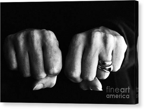 Woman Clenching Two Hands Into Fists In A Fit Of Aggression Canvas Print by Sami Sarkis