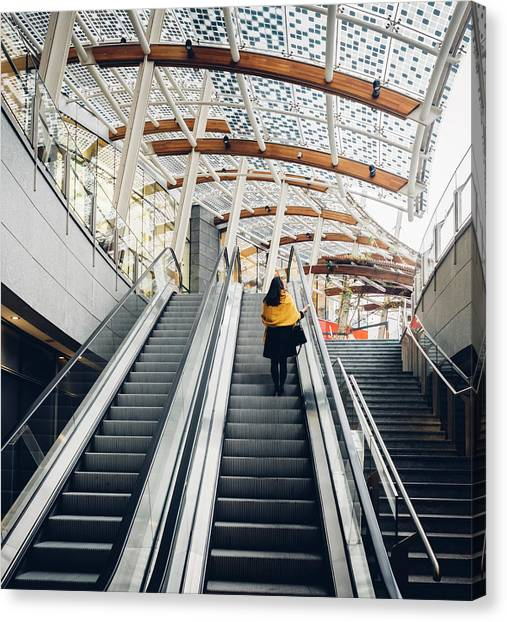 Woman Going Up Escalator In Milan, Italy Canvas Print