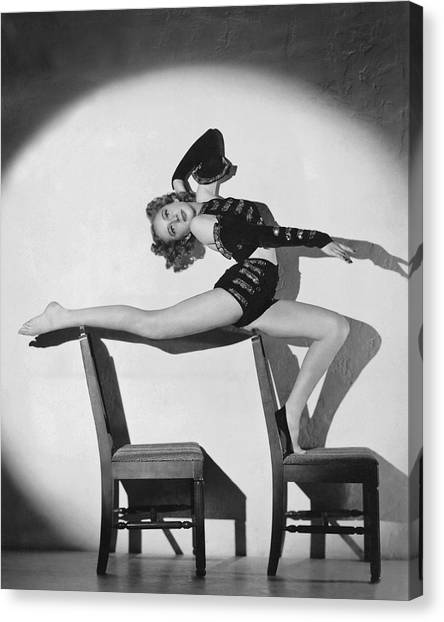 Acrobatic Canvas Print - Woman In Acrobatic Dance Pose by Underwood Archives