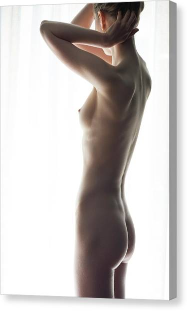 Woman In Front Of Curtain Canvas Print