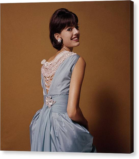 Woman Looks Over Her Shoulder Canvas Print by Bert Stern