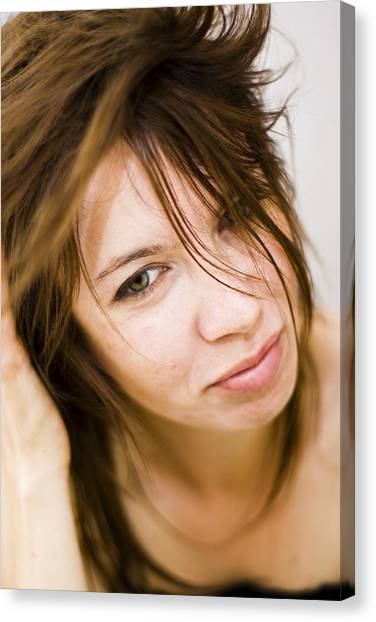 Woman Shaking Her Hair Canvas Print by Gabor Pozsgai